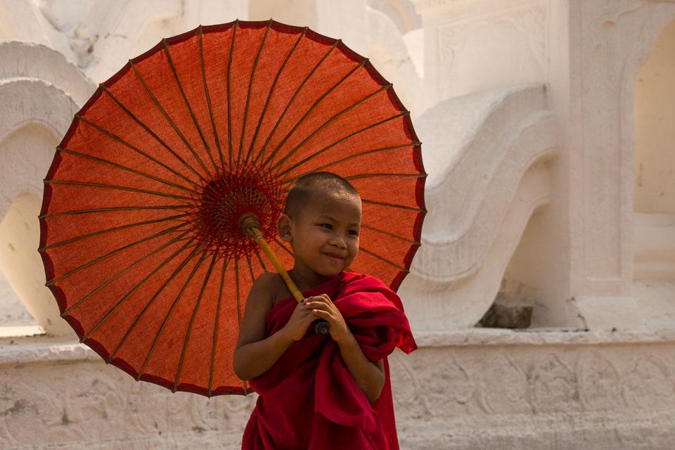 """Smiling Monk under an Umbrella"" by Emma Jones"
